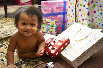 toddler opening gifts